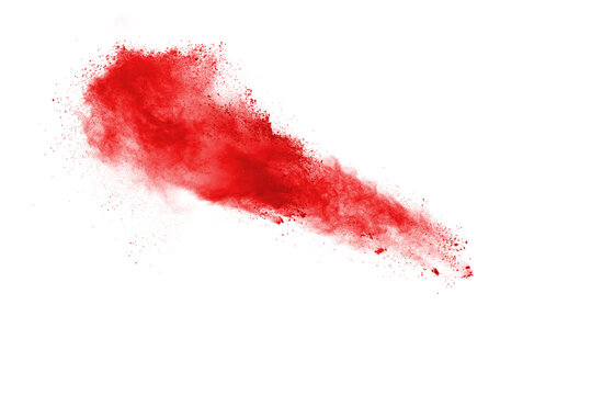 Freeze motion of red color powder exploding on white background.