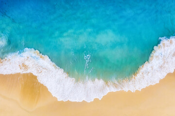Obraz Beach and large ocean waves. Coast as a background from top view. Blue water background from drone. Summer seascape from air. Travel image - fototapety do salonu