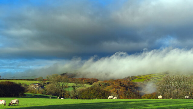 Autumn morning on the moors, with clouds, mist & sunshine.