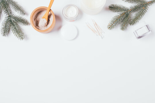 Winter skin care cosmetics and green fir branches