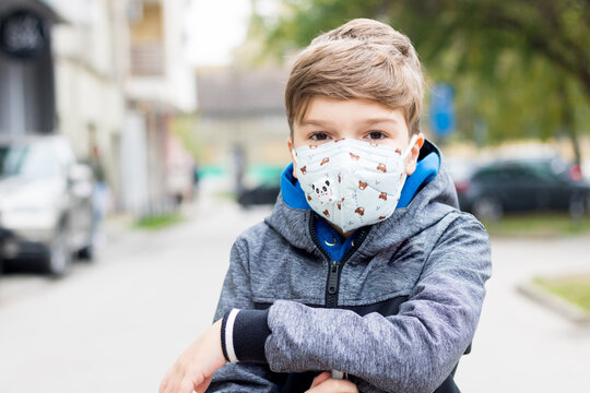 Portrait of a child with protective face mask due to coronavirus pandemic.