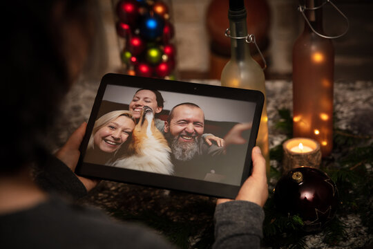 a woman is having a video conference at home with a group of friends
