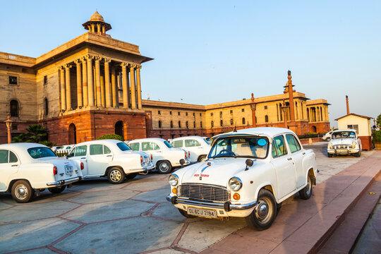 Official Hindustan Ambassador cars parked outside North Block, Secretariat Building, New Delhi