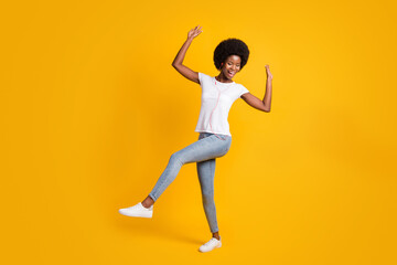 Full length body size photo of female hipster with black skin listening favourite song dancing with...