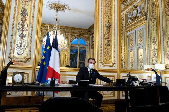 French President Macron speaks on the telephone with U.S. president elect Biden