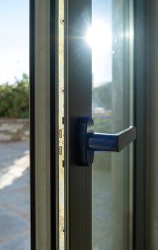 Aluminum door window closeup view, blurry background