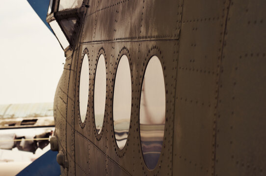 View of a row of elevators of an old plane standing at the airfield