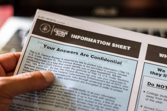 A hand holding an Information Sheet about Confidentiality from the US Census Bureau. July 29, 2020, Chicago Illinois