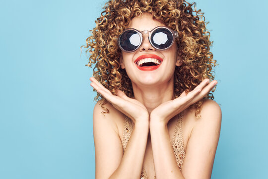 woman Curly hair smile charm attractive look glasses bright makeup