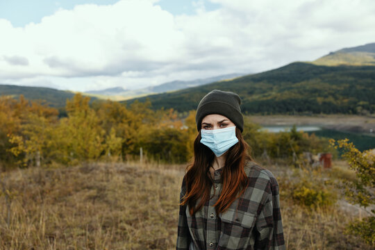 Woman tourism travel medical mask Autumn forest nature
