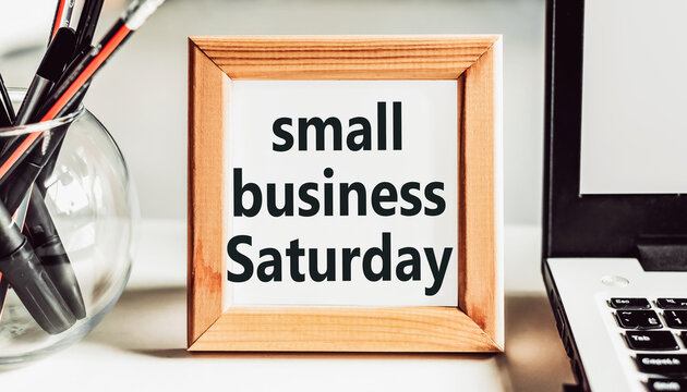 Small Business Saturday text in wooden frame on office table