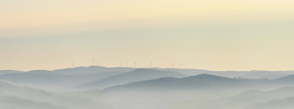 Wind power stations - wind turbines on the horizon, in the mountains, sky