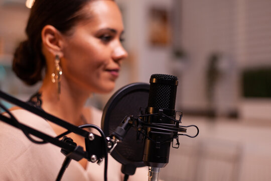 Vlogger woman recording video for her blog in home studio. On-air online production internet broadcast show host streaming live content, recording digital social media communication