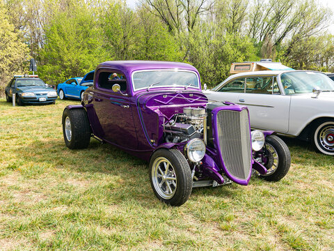Front view of a restored purple circa 1932 ford deuce coupe