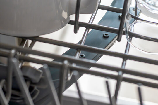 close up dishwasher spray arm with water holes