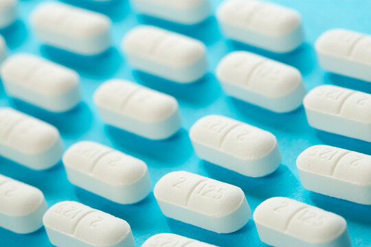 Rounded white pills on blue background
