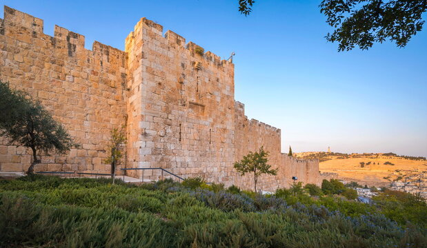 Southern wall of the Old City Jerusalem leading from the Zion's Gate down towards the Temple Mount, with Mount of Olives and its Russian Church of Ascension in the background