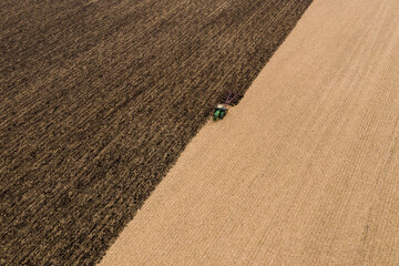 A Tractor Plows a Field and Leaves a Pattern from Above