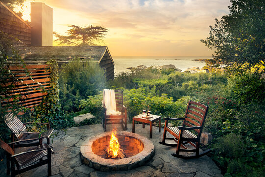 Outdoor fireplace by cabin and ocean