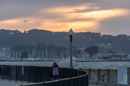 San Francisco, California - March 2020: Sunset descends on the skies and marina behind the Municipal Pier at San Francisco Maritime National Historical Park.