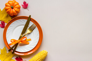 Thanksgiving day dinner table with autumn vegetables and cutlery, top view