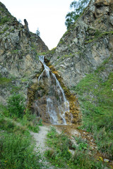 View of Caucasian waterfall with glacial water in Dzhily-Su tract
