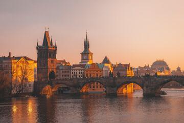 Prague, Charles Bridge with Vltava river at sunset