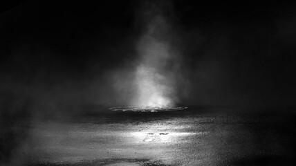 Dark street, black background, glare of light on the wet asphalt. Rays and lines, smoke. Dark city street. Fotomurales