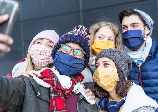 Group of friends taking selfie during Coronavirus breakdown - Young milenial people sharing photo on social media networks