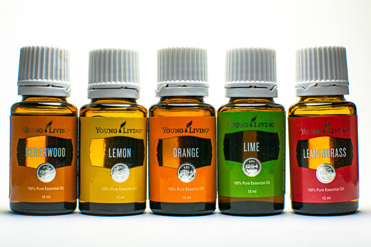 Cedarwood, lemon, orange, lime and lemongrass Young Living essential oil with white background