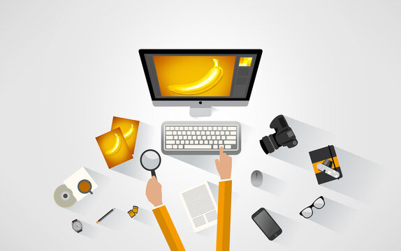 Photographer working at the desk. Yellow tones. Illustration with DLSR camera, photos, image manipulation software, memory cards and other photography equipment