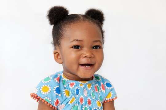 Portrait of smiling baby girl with hair buns