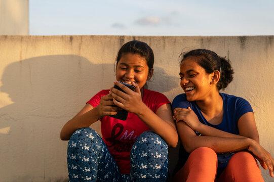 Teenage girl watching movies in smartphone