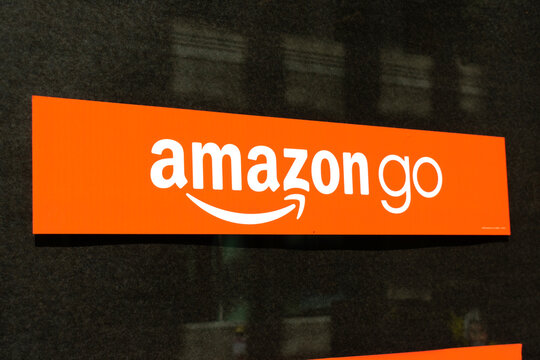 Amazon Go sign on store window. Amazon Go is a chain of cashless convenience stores with automated checkout, operated by Amazon - San Francisco, California, USA - 2020