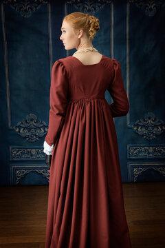 A regency woman wearing a white muslin dress