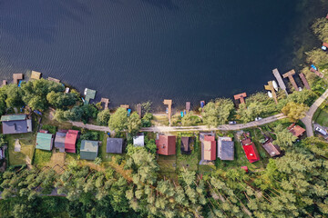 Obraz Drone view of summer cottages over Narie lake of Ilawa Lake District in Kretowiny, small village in Warmia Mazury region of Poland - fototapety do salonu