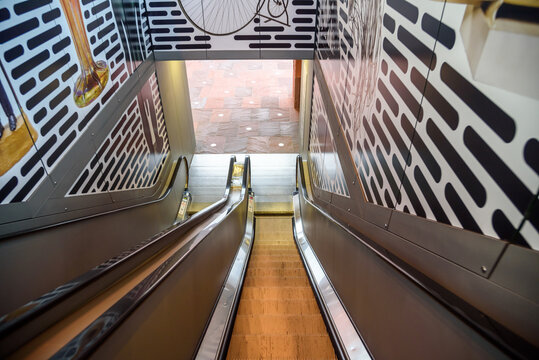 View from the top of an empty escalator in a shopping centre