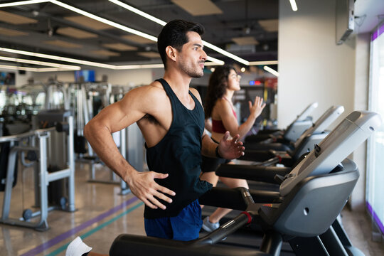 Latin man doing a cardio workout in a treadmill