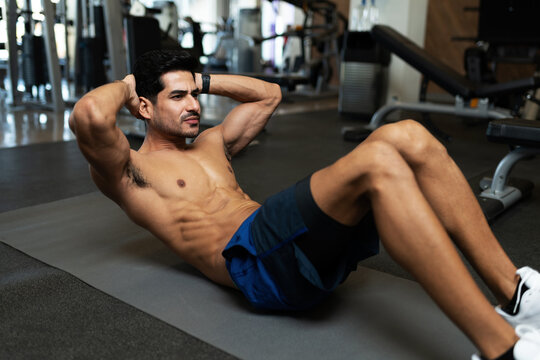 Strong man working out with abdominal crunch exercises