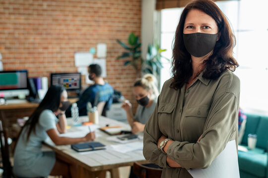 Businesswoman in face mask at the office