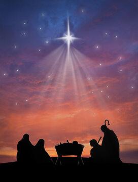 Christmas nativity scene of baby Jesus in the manger with Joseph, Mary, shepherd and sheeps