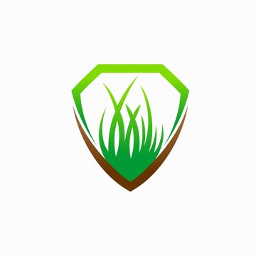 shield logo with green grass