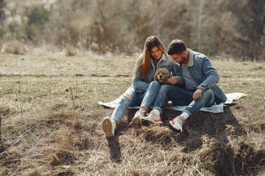 Woman in a jeans clothes. Couple in a spring forest. People with a cute dog.