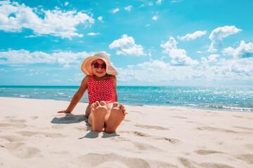 cute little girl enjoy vacation on sand tropical beach