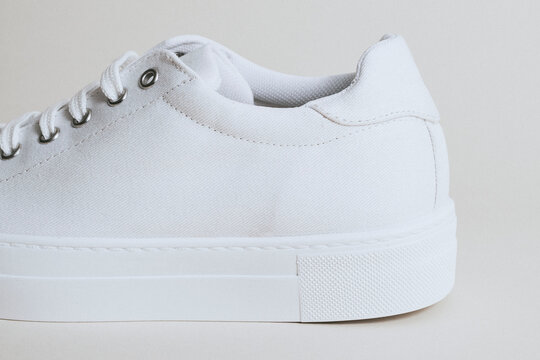Woman's white canvas sneaker mockup on white