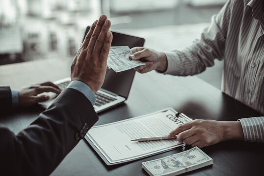 Businessman refuses to receive a bribe.