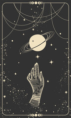 Obraz Tarot card with hand and planet. Magic card, boho design, tattoo, engraving, cover for the witch. Golden mystical hand drawing on a black background with stars - fototapety do salonu