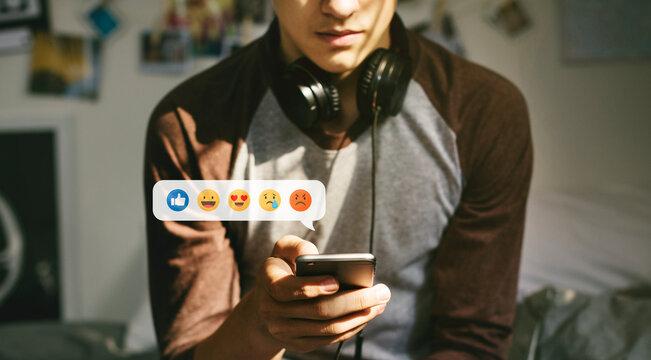 Teen using emojis