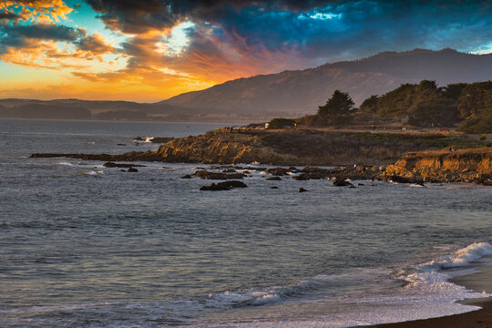 Surfing at sunset at Moonstone beach in Cambria