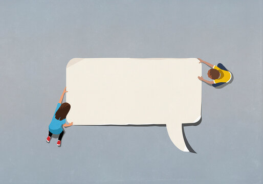 Boy and girl at edge of blank speech bubble